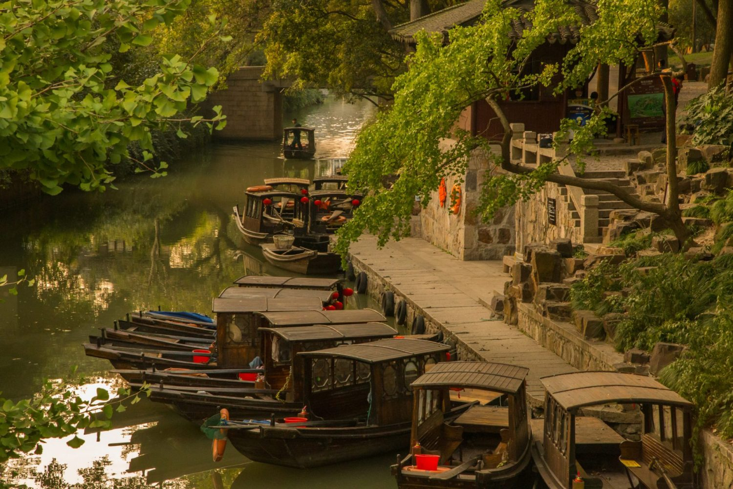 The Suzhou water canals ancient town in the suburbs of the Shanghai city, a nice travel destination with typical chinese construction, water canals, boat trips and red chinese lanterns.